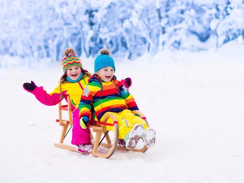 Boy and girl sledding