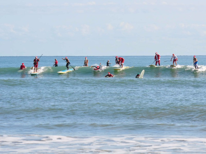Surfing Santas Cocoa Beach