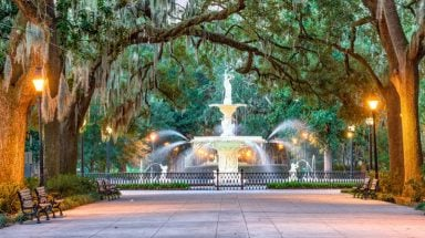 Large fountain surrounded by moss-draped trees in Savannah, Georgia