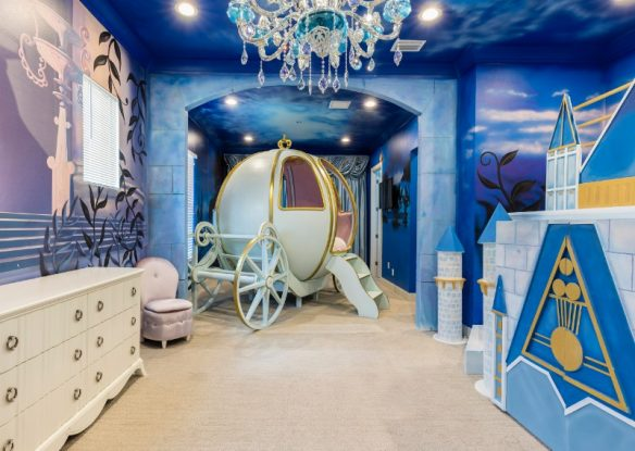 A Cinderalla-themed room with carriage and chandelier