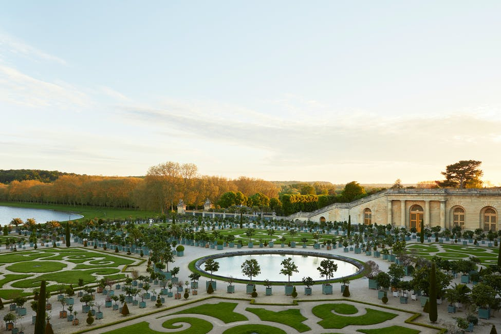 A view of the Orangerie at the Palace of Versailles, one of many grand gardens you can see from the Airelles Château de Versailles, Le Grand Contrôle