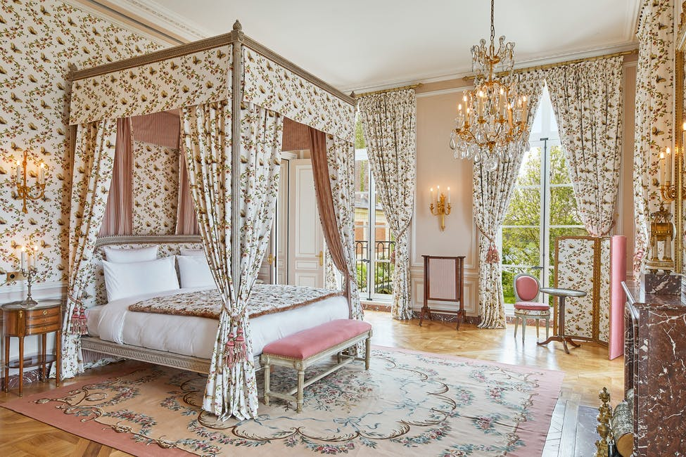 A suite at Airelles Chateau de Versailles Le Grande Controle decorated in 18th century style with period furniture, decor and artifacts