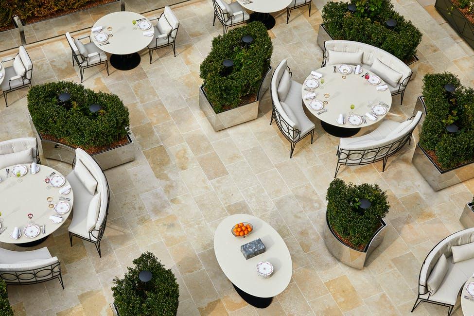 An aerial view of the restaurant terrace at Airelles Chateau de Versailles Le Grande Controle