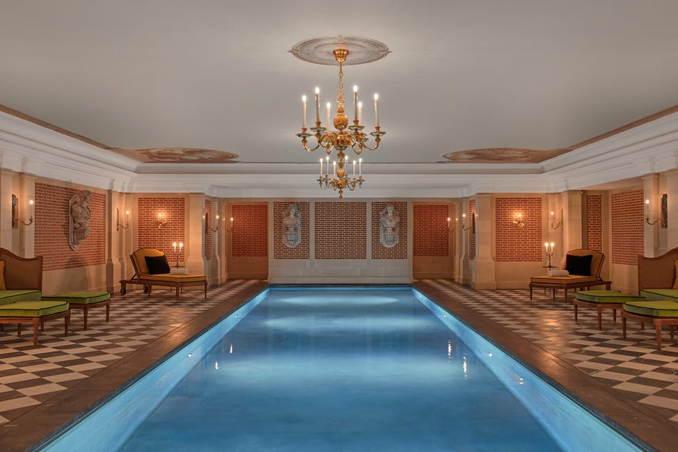 A view of the Valmont Spa's swimming pool at Airelles Chateau de Versailles Le Grande Controle