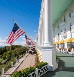 The large porch at the Grand Mackinac Hotel decorated with American flags