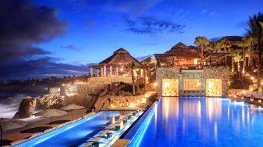 The pool at night at Esperanza Resort in Los Cabos