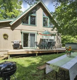 Grill and Picnic Table Outside Fabulous Creekside Cabin