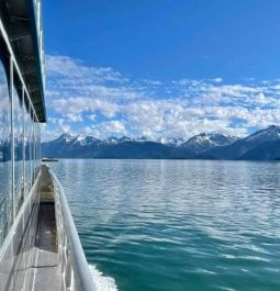 Boat cruising through the waters of Glacier Bay on Glacier Bay Tour