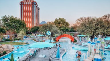 outdoor water play area with buildings in the backdrop