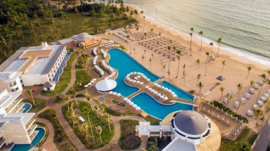 aerial show of outdoor pools and sandy beach