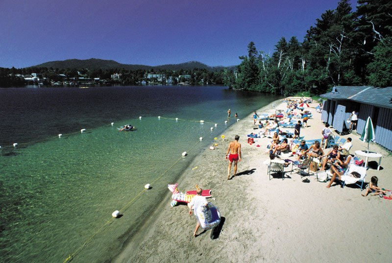 An aerial view of a private beach on Mirror Lake near the Crowne Plaza Lake Placid Resort
