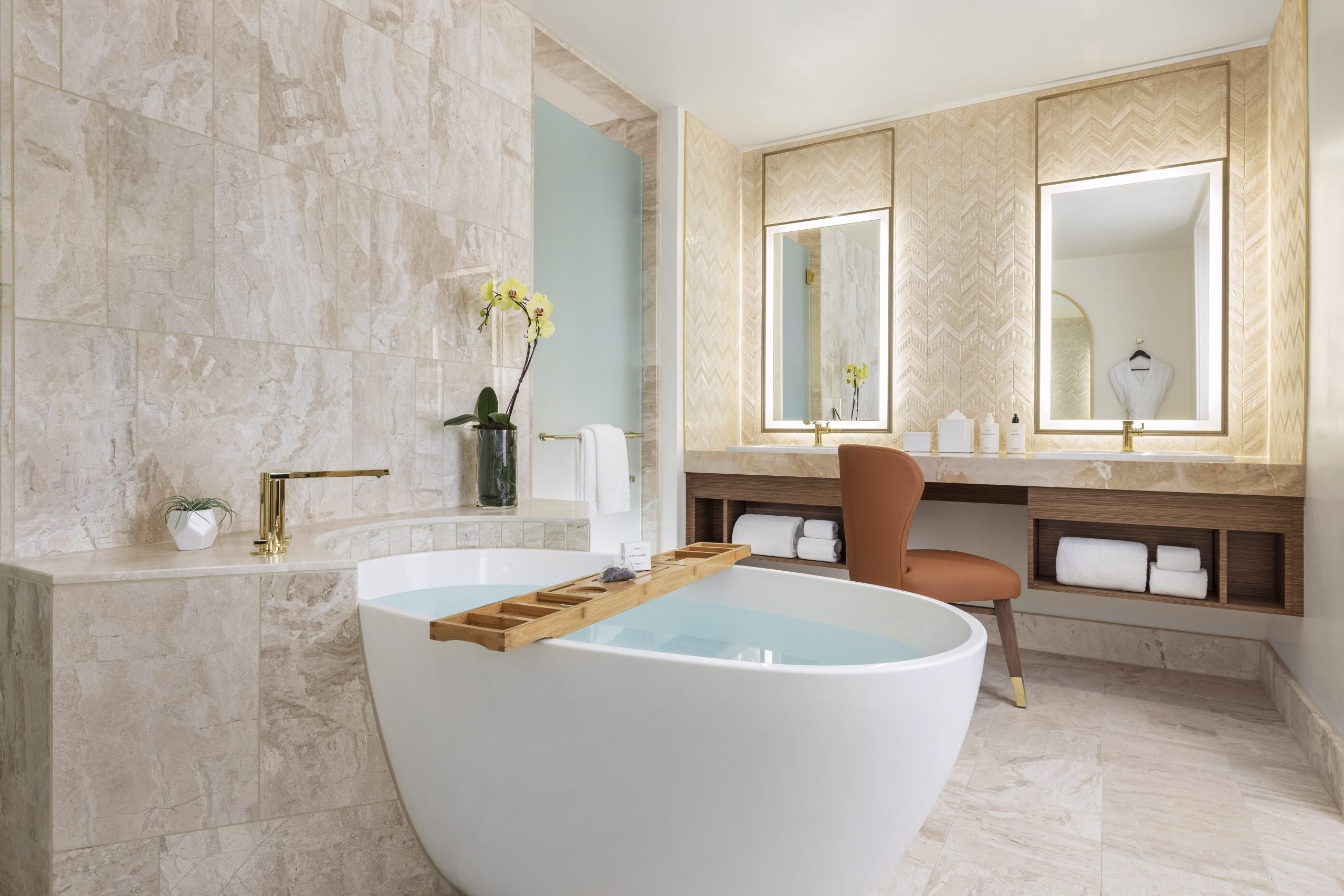 Deep soaking tub and luxurious amenities in a guest bathroom at Resorts World Las Vegas