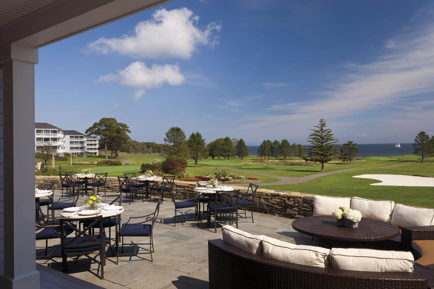 Outdoor dining area with tables and chairs at Samoset Resort, Maine