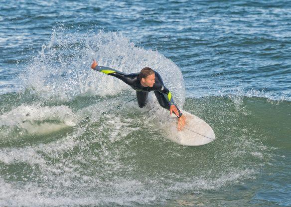 A surfer rides the waves at Sebastian Inlet, Florida