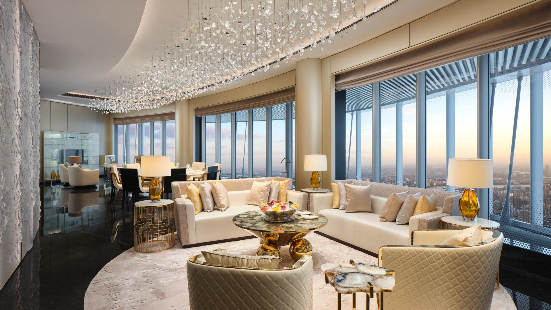 The Shanghai Suite living room at J Hotel has panoramic views of Shanghai and decorated in elegant furniture.