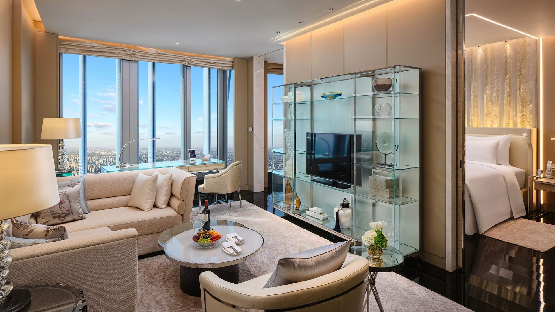 The living room of the grand suite at J Hotel Shanghai features modern decor and skyline views.