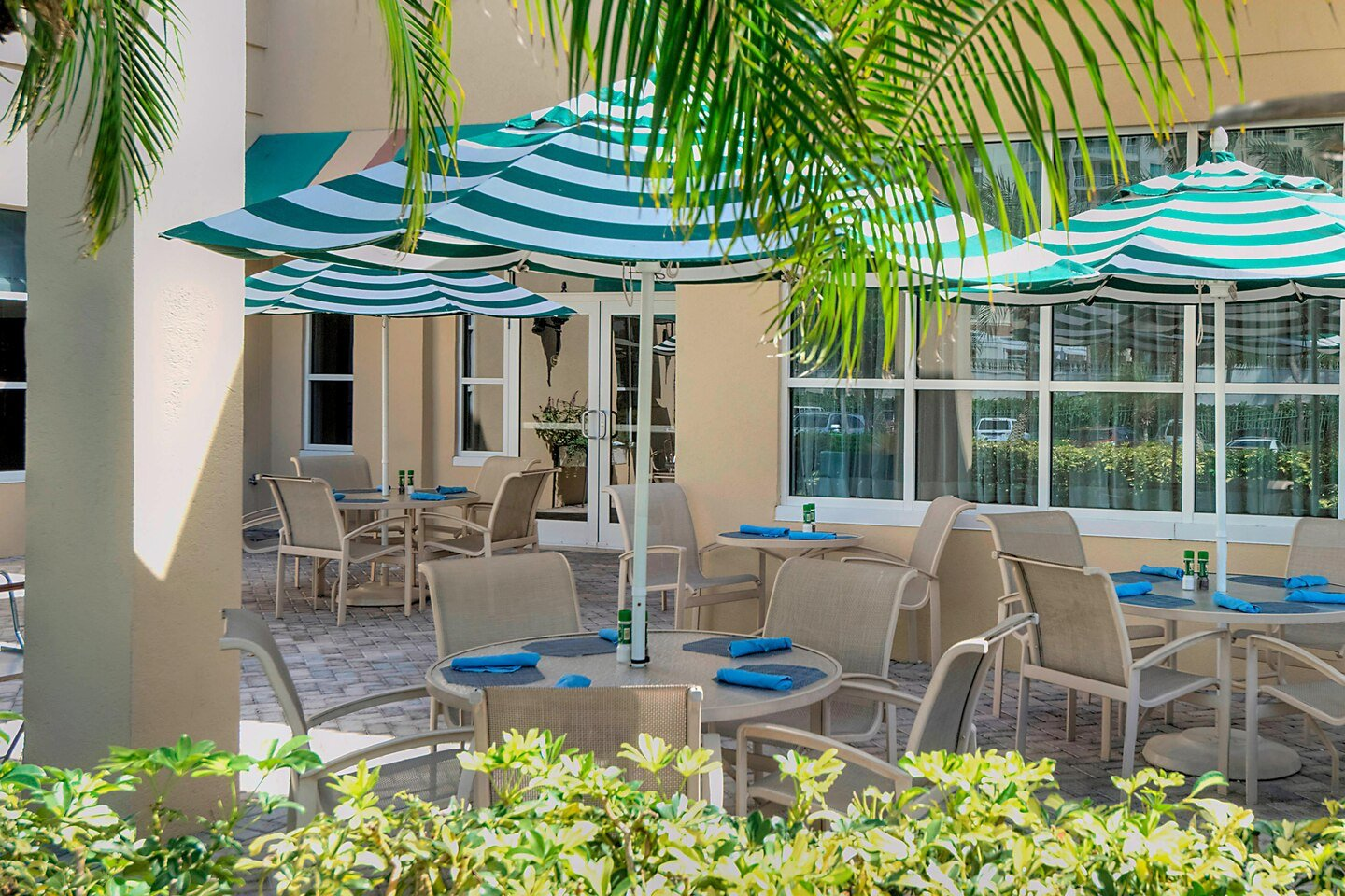 Outdoor tables and chairs with umbrellas for dining