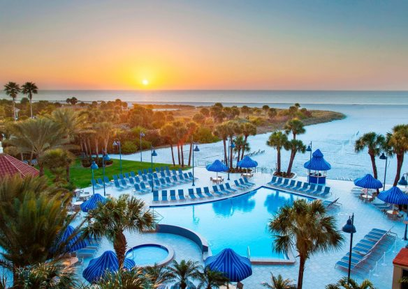 Outdoor pool view at sunset