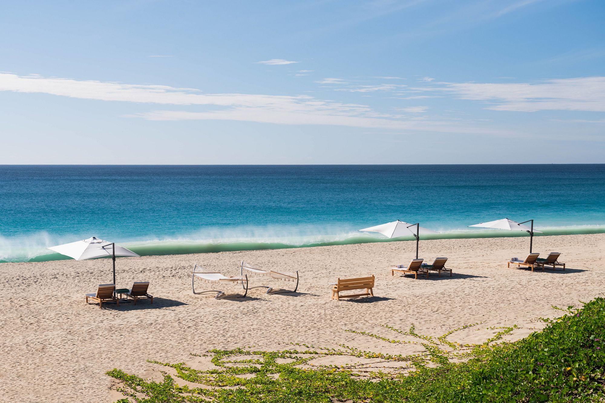 Beach chairs in front of a blue Caribbean sea at Ritz-Carlton Turks & Caicos