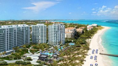 An aerial view of the new RItz-Carlton Turks & Caicos resort on Grace Bay beach.