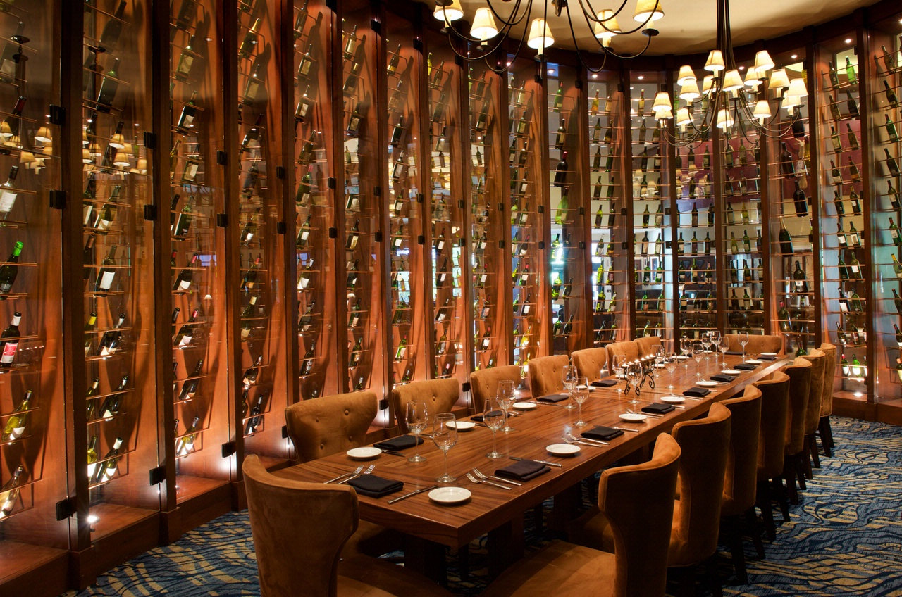 Restaurant and bar seating with wine bottles