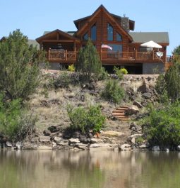 Grand log home on hill overlooking the lake