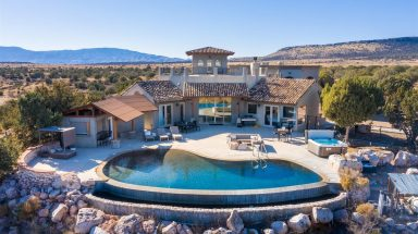 Beautiful Luxury Home with Infinity Pool surrounded by red rock views