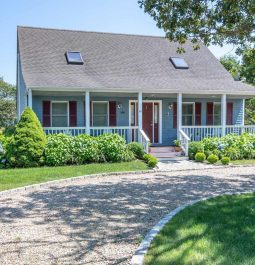 A charming cottage with a large front porch and an inviting entrance in Martha's Vineyard