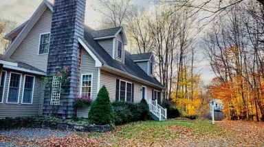 Side exterior view of the home with fall leaves