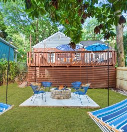 backyard area with view of patio and hammocks