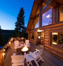 View of the deck with a fire pit at Log Cabin on the River with a Hot Tub