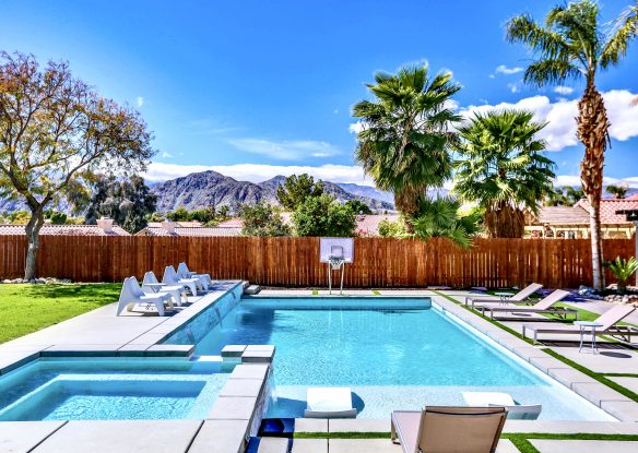 large pool area with mountain views