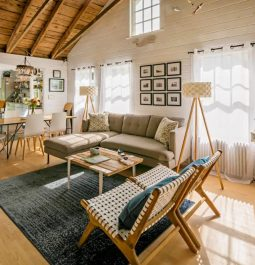 Exposed beams and modern interiors transform this traditional Martha's Vineyard cottage