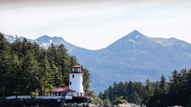 red and white lighthouse on an island in Sitka