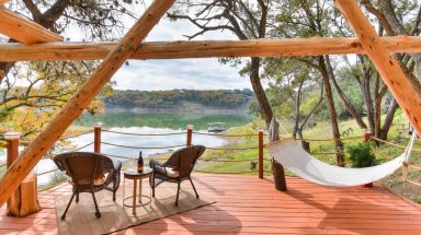 Patio scene with hammock and water view