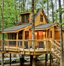 A poplar treehouse stands tall among the trees in a treehouse community in Gatlinburg, Tennessee