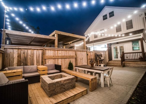 Outdoor seating area lit up at night
