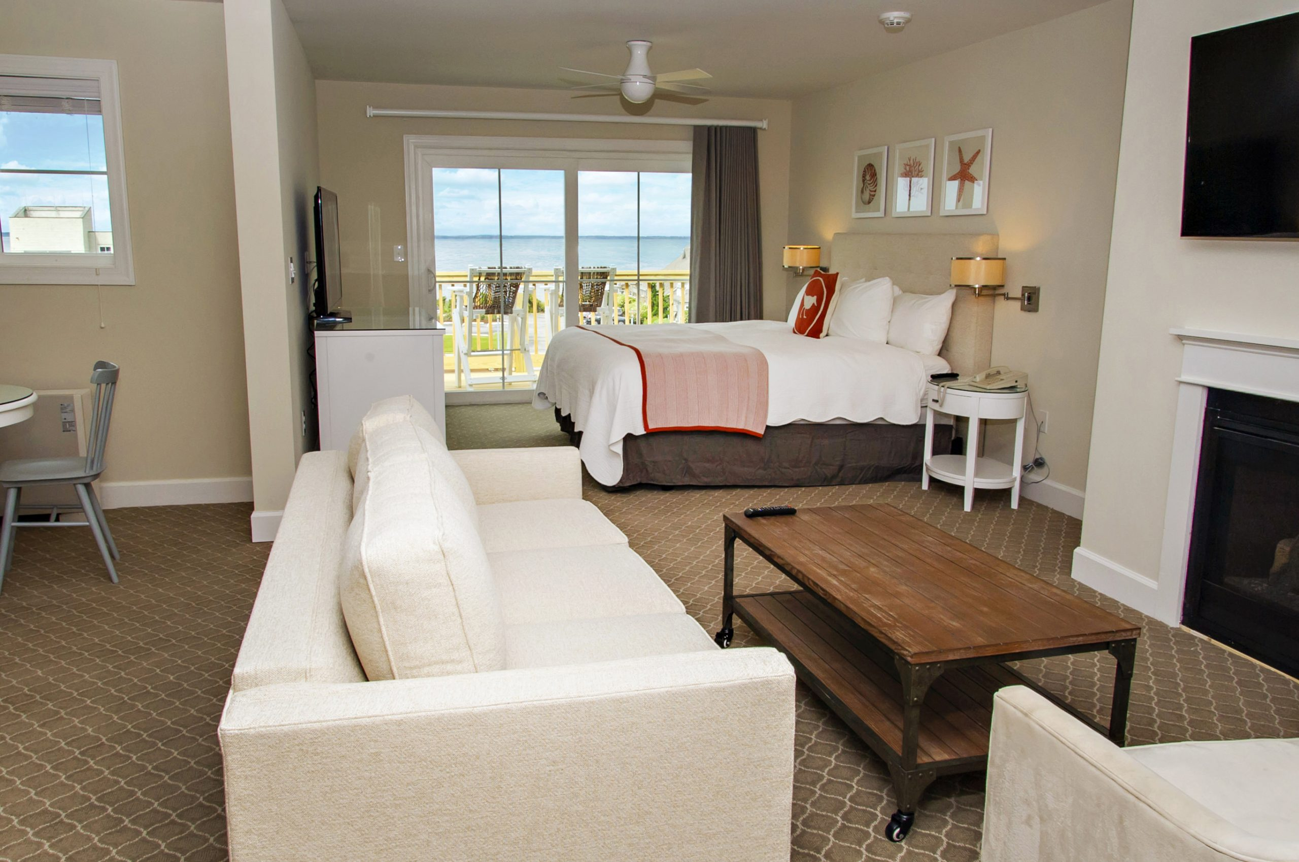 Room interior with couch seating and ocean view