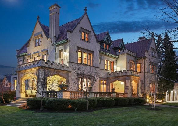 old school mansion with green lawn