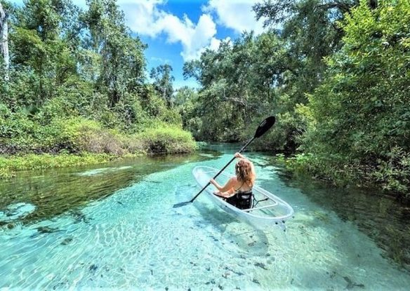 Kayaking in the blue water surrounded by stunning views