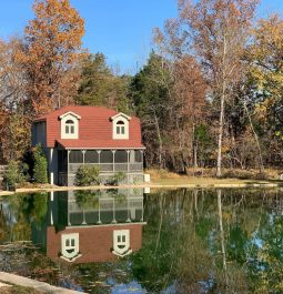 An adorable cottage sits waterside by a private pond in West Virginia