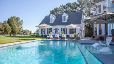 View of home with pool in front