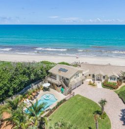 aerial view of house next to beach