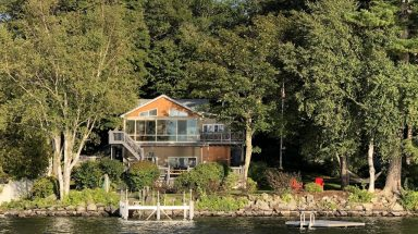 view of the Spectacular Maine Cobbossee Lakefront Home from the lake