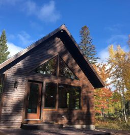 Exterior of cabin with trees in back