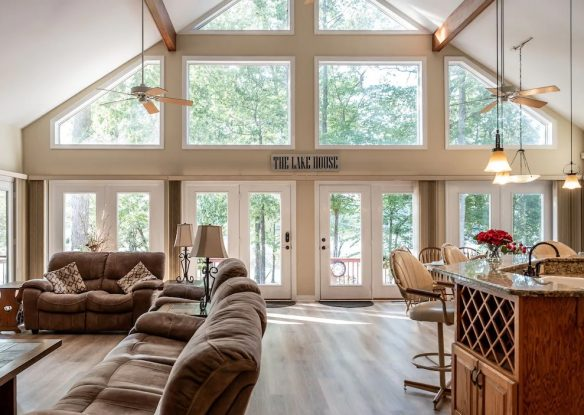 Large windows illuminate a spacious living room