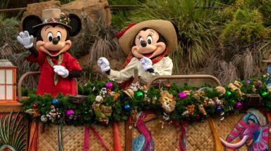 Mickey and Minnie float down Animal Kingdom's Discovery River on a festive flotilla.