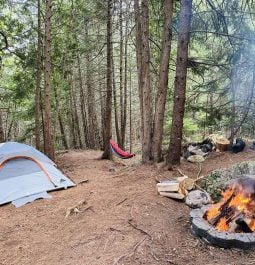 Tent and fire pit at campground