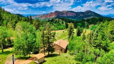 Aerial view of Secluded Retreat with Private Hot Tub surrounded by trees and mountains