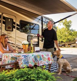 Couple and dog outside RV